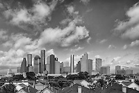 I do like converting some photos into black and white. In this cityscape from Houston, Texas, the skyline is graces by some soft afternoon clouds floating by. I liked the contrast of what was going on... houses in the foreground, downtown in the center, and soft skies overhead.
