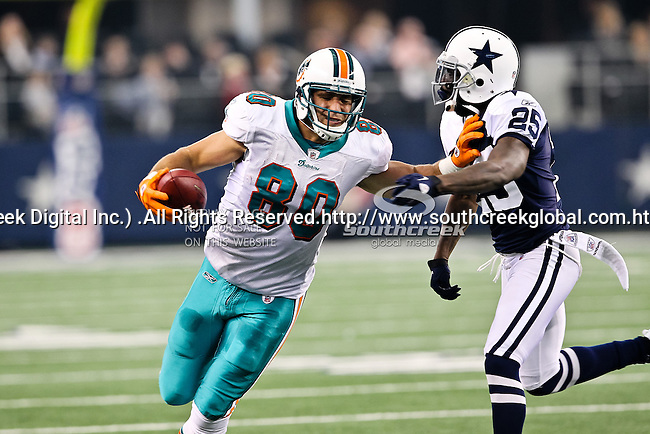 Miami Dolphins tight end Anthony Fasano (80) and Dallas Cowboys defensive back Frank Walker (25) in action during the Thanksgiving Day game between the Miami Dolphins and the Dallas Cowboys at the Cowboys Stadium in Arlington, Texas. Dallas defeats Miami 20 to 19...
