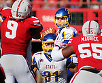 LINCOLN, NE - SEPTEMBER 21, 2013:  South Dakota State quaterback Austin Sumner looks for a a receiver with protection from Zach Zenner #31 as Jason Ankrah #9 and Kevin Maurice #55 of Nebraska give pressure.  (Photo by Dick Carlson/Inertia)