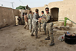 U.S. and Canadian soldiers move boxes of water into a compound they have taken over for a new outpost in the village of Deh-e-Chowkay, in the Arghandab valley near Kandahar, Afghanistan. May 23, 2010. DREW BROWN/STARS AND STRIPES