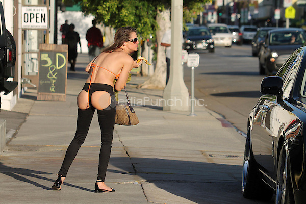 "Alicia Arden, the ""Hoarding: Buried Alive"" and ""General Hospital"" star, wears XPOZ jeans with cutouts in the front and back while shopping on Melrose Ave., Los Angeles, CA October 7, 2015. Credit: David Edwards/MediaPunch"