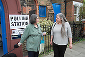 Angie Durrance, election candidate for Queen's Park Community Council, with a voter outside St.Jude's Hall, Ilbert Street.