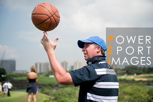 Robbie Fowler throws a basketball during the World Celebrity Pro-Am 2016 Mission Hills China Golf Tournament on 23 October 2016, in Haikou, Hainan province, China. Photo by Weixiang Lim / Power Sport Images