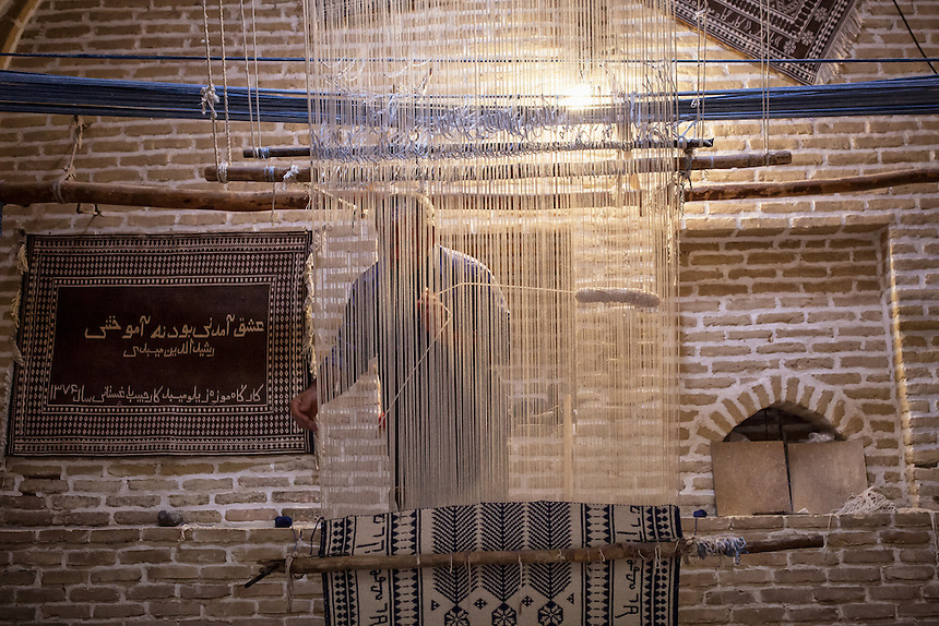 A Rug maker shows the process of making Persian rug at his workshop in Meybod. Other than workshop this place also functiones as a museum for the centuries old carpets.