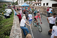 pure chaos at the stage finish; riders, fans, press & organisers simply blocked in the small street that was the finish line... red jersey (overall leader) Primoz Roglic (SVK/Jumbo-Visma) escaping with a swift turnaround to head back to the podium (next to the finish line)<br /> <br /> Stage 11: Saint-Palais to Urdax-Dantxarinea (180km in The Basque Country > FRA & ESP) <br /> La Vuelta 2019<br /> <br /> ©kramon