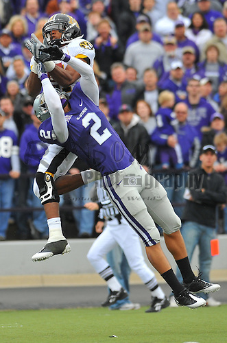 Nov 14, 2009; Manhattan, KS, USA; Missouri wide receiver Danario Alexander (81) makes the catch in the first half as Kansas State defensive back Tysyn Hartman (2) attempts coverage at Bill Snyder Family Stadium. Mandatory Credit: Denny Medley-US PRESSWIRE