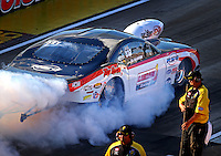 Sep 2, 2016; Clermont, IN, USA; NHRA pro mod driver Khalid Albalooshi does a burnout during qualifying for the US Nationals at Lucas Oil Raceway. Mandatory Credit: Mark J. Rebilas-USA TODAY Sports
