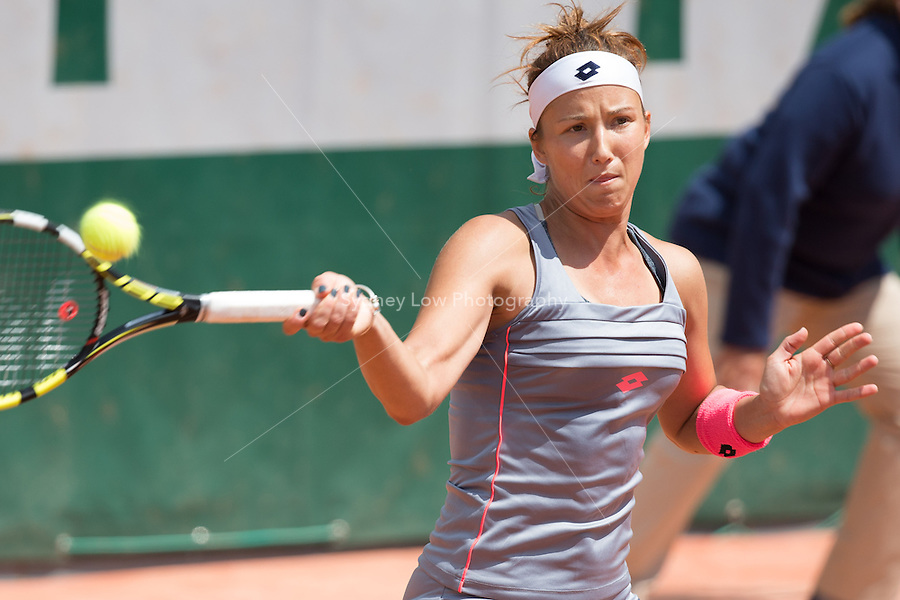 May 25, 2015: Paula Kania (POL) in action in a 1st round match against  Mona Barthel (GER) on day two of the 2015 French Open tennis tournament at Roland Garros in Paris, France. Kania won 57 62 64. Sydney Low/AsteriskImages