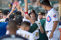 Mesa Solar Sox shortstop Eli White (21), of the Oakland Athletics organization, is congratulated by his teammates in the dugout after hitting a home run during an Arizona Fall League game against the Surprise Saguaros at Sloan Park on November 1, 2018 in Mesa, Arizona. Surprise defeated Mesa 5-4 . (Zachary Lucy/Four Seam Images)