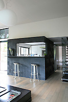 The breakfast bar in the living/dining area is directly accessed from the kitchen via a large hatch