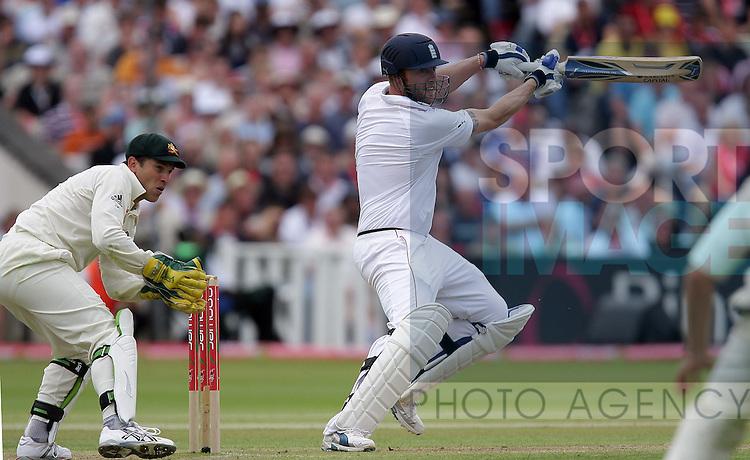 England  batsman Andrew Flintoff hits out in front of Austarlian wicketkeeper Graham Manou