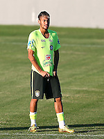 Neymar of Brazil pulls at his shirt during training ahead of tomorrow's World Cup quarter final vs Colombia tomorrow