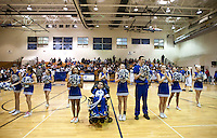 The Grandview High School unified cheerleading squad during halftime in a game against Overland High School at Grandview High School in Aurora, Colorado, Wednesday, February 1, 2012. Unified sports teams, an outgrowth of the Special Olympics, are teams with both special needs and traditional high school students as players. The idea is that special needs kids shouldn't be separated and be allowed to participate in a competitive games as well at their schools...Photo by Matt Nager