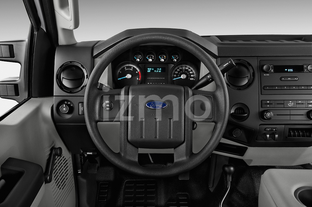 Steering wheel view of a 2013 Ford F-450 XLT Super Duty Crew Cab Truck.
