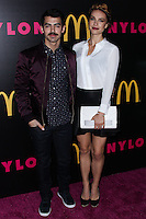 WEST HOLLYWOOD, CA - DECEMBER 05: Joe Jonas and his girlfriend Blanda Eggenschwiler arrive at the Nylon Magazine December 2013/January 2014 Cover Launch Party held at Quixote Studios on December 5, 2013 in West Hollywood, California. (Photo by Xavier Collin/Celebrity Monitor)
