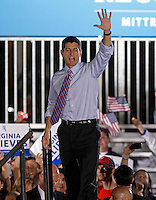 Republican vice presidential nominee Paul Ryan waves goodbye to his supporters during a campaign stop Thursday evening at the Crutchfield Corporation in Albemarle County, Va.