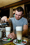 "BRUSSELS - BELGIUM - 08 JANUARY 2012 -- Marolles the bohemian city part of Brussels. -- Cafe La Brocante (corner of rue Blaes and Place Jeu de Balle) is a ""must place"" when visiting the flee-market. Sebastian creating the house speciality a beautifully layered Cafe macchiato. -- PHOTO: Juha ROININEN /  EUP-IMAGES"