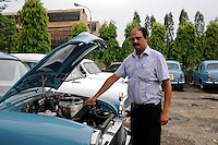 INDIA Kolkata Calcutta , HM Hind Motors car factory, here the Ambassador is still produced after license of Oxford Morris, new painted blue cars for the navy / INDIEN Kolkata Kalkutta , Fabrik HM Hind Motors, Herstellung von Ambassador , der HM Ambassador laeuft heute noch neu nach Vorlage des Oxford Morris bei HM Hindustan Motors vom Band