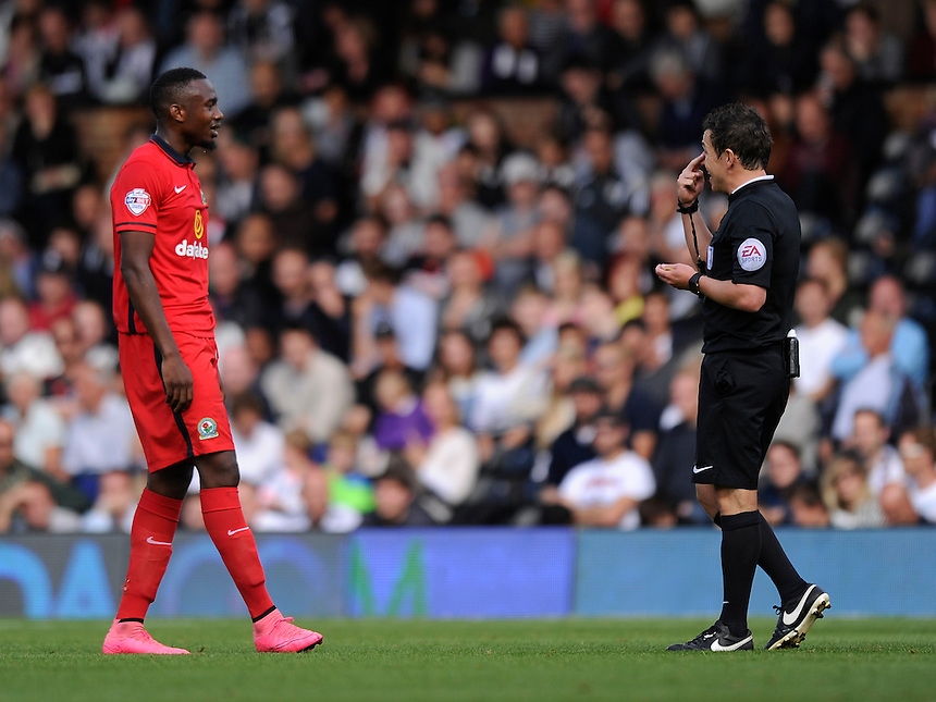 Blackburn Rovers' Bengadli-Fode Koita is shown a yellow card by Referee Tony Harrrington<br /> <br /> Photographer Ashley Western/CameraSport<br /> <br /> Football - The Football League Sky Bet Championship - Fulham v Blackburn Rovers - Sunday 13th September 2015 - Craven Cottage<br /> <br /> &copy; CameraSport - 43 Linden Ave. Countesthorpe. Leicester. England. LE8 5PG - Tel: +44 (0) 116 277 4147 - admin@camerasport.com - www.camerasport.com
