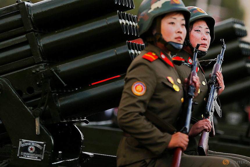 A soldier (R) cries as her vehicle with rocket launchers drives past a stand with North Korean leader Kim Jong Un during the parade celebrating the 70th anniversary of the founding of the ruling Workers' Party of Korea, in Pyongyang October 10, 2015. Isolated North Korea marked the 70th anniversary of its ruling Workers' Party on Saturday with a massive military parade overseen by leader Kim Jong Un, who said his country was ready to fight any war waged by the United States.   REUTERS/Damir Sagolj