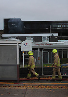 Pictured: The closed off Tycoch Road at the scene of a large fire at the Gower College Swansea in the Tycoch area of Swansea, Wales, UK. Friday 28 October 2016<br />Re: About 100 firefighters have been tackling a large fire at Gower College Swansea.<br />Mid and West Wales Fire Service was called to Gower College on Tycoch Road, Sketty, just before 4:30am on Friday.<br />It said the fire covered the second and third floors of a four-storey building but it is now under control.<br />There were about 20 fire appliances at the scene, the incident is ongoing and Tycoch Road is shut.