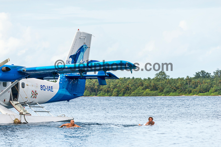 Four Seasons,Kuda Huraa, Maldives (Monday, August 10, 2015)  Shane Dorian (HAW) and Neco Padaratz (BRA). The surf had jumped today to around 4'-6' from the South East.  There was a session at the famed 'Sultans Point' which was effected for brief time by a passing rain squall but conditions turned glassy once the rain stopped and the wind dropped.  Photo: joliphotos.com