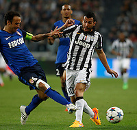 Calcio, quarti di finale di andata di Champions League: Juventus vs Monaco. Torino, Juventus stadium, 14 aprile 2015.<br /> Juventus' Carlos Tevez, right, is challenged by Monaco's Ricardo Carvalho during the Champions League quarterfinals first leg football match between Juventus and Monaco at Juventus stadium, 14 April 2015.<br /> UPDATE IMAGES PRESS/Isabella Bonotto