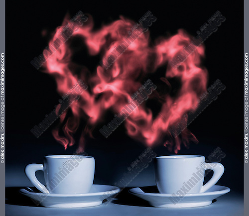 Two cups coffee with steam shaped at two hearts rising above them