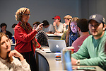 Students in professor Kathleen Wickham's Journalism 575 Ethics course work on group case studies during their winter intercession class. Photo by Thomas Graning/Ole Miss Communications