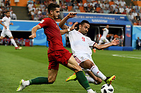 SARANSK - RUSIA, 25-06-2018: Omid EBRAHIMI (Der) jugador de RI de Irán disputa el balón con Aandre SILVA (Izq) jugador de Portugal durante partido de la primera fase, Grupo B, por la Copa Mundial de la FIFA Rusia 2018 jugado en el estadio Mordovia Arena en Saransk, Rusia. / Omid EBRAHIMI (R) player of IR Iran fights the ball with Aandre SILVA (L) player of Portugal during match of the first phase, Group B, for the FIFA World Cup Russia 2018 played at Mordovia Arena stadium in Saransk, Russia. Photo: VizzorImage / Julian Medina / Cont