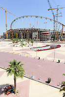 QATAR, Doha, construction site Khalifa International Stadium for FIFA world cup 2022, built by contractor midmac and sixt contract, in palm shade contact worker of company Nakheel / KATAR, Doha, Baustelle Khalifa International Stadium fuer die  FIFA Fussballweltmeisterschaft 2022, im Schatten der Palme Arbeiter der Firma Nakheel