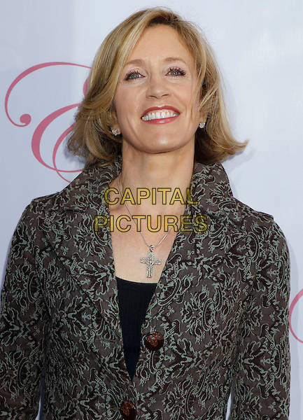 """FELICITY HUFFMAN.""""Eva"""" by Eva Longoria Fragrance Launch Event held at at Beso Hollywood, Hollywood, California, USA..April 27th, 2010.perfume half length  print pattern black grey gray coat silver cross necklace crucifix.CAP/ADM/MJ.©Michael Jade/AdMedia/Capital Pictures."""
