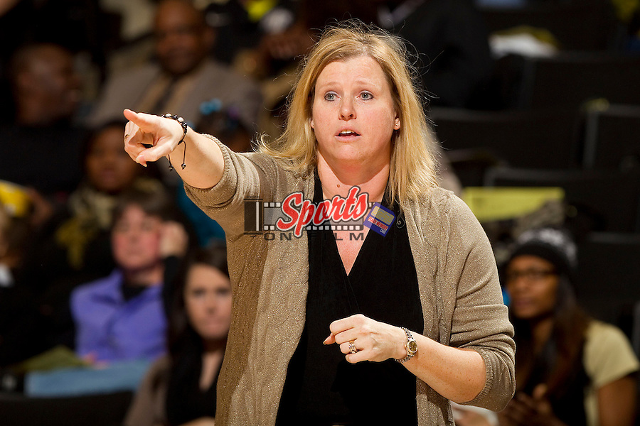 Wake Forest Demon Deacons head coach Jen Hoover gives instructions to her team during second half action against the North Carolina State Wolfpack at the LJVM Coliseum on January 6, 2013 in Winston-Salem, North Carolina.  The Demon Deacons defeated the Wolfpack 69-56.    (Brian Westerholt/Sports On Film)