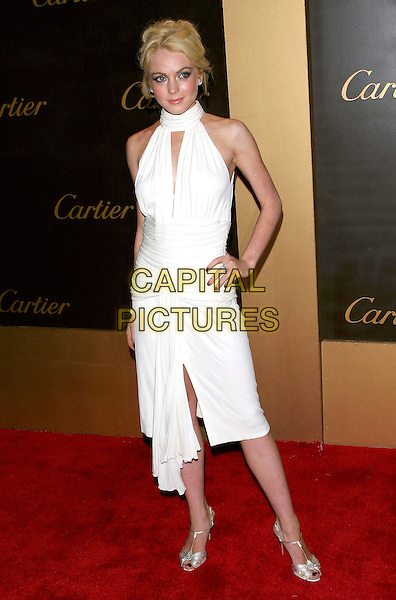 LINDSAY LOHAN.Cartier Celebrates 25 Years In Beverly Hills In Honor Of Project A.L.S. held on Rodeo Drive..May 9th, 2005.Photo Credit: Jacqui Wong/AdMedia.full length white halterneck dress hand on hip.www.capitalpictures.com.sales@capitalpictures.com.© Capital Pictures.
