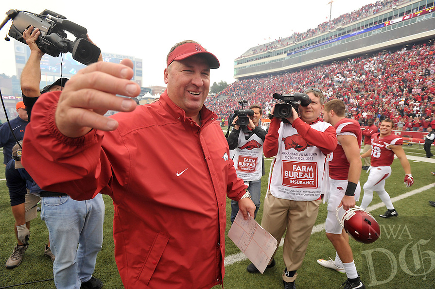 NWA Democrat-Gazette/MICHAEL WOODS • @NWAMICHAELW<br /> University of Arkansas players coach Bret Bielema celebrates with his team after the Arkansas Razorbacks 54-46 win in 4 overtimes over Auburn after Saturdays game at Razorback Stadium in Fayetteville.