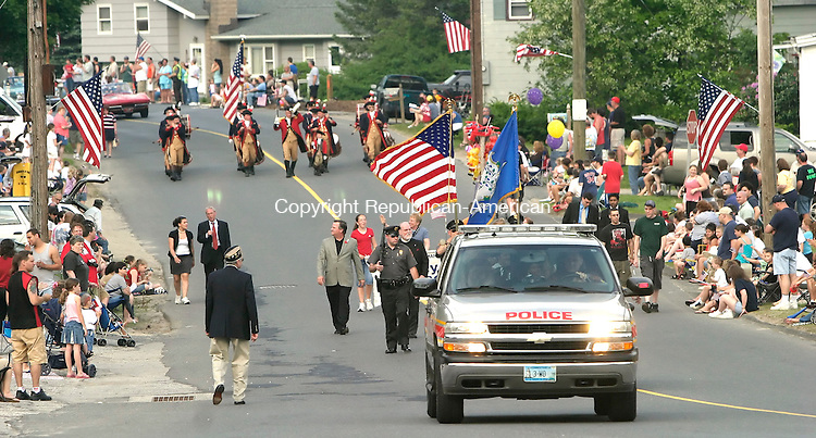 WOLCOTT, CT, 29 May 2006- 052906BZ01- A Wolcott Police vehicle leads the annual Memorial Day Parade as hundreds of spectators lined the streets.<br /> Jamison C. Bazinet Republican-American