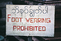 A common sign in and around Burma's Buddhist temples and shrines, where all visitors must remove their shohes before entering.