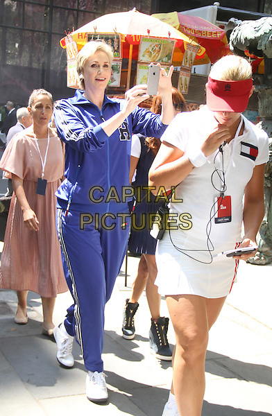 August 25, 2015: Jane Lynch at Tommy Hilfiger &amp; Rafael Nadal Launch Global Brand Ambassadorship at Bryant Park  in New York .<br /> CAP/MPI/RW<br /> &copy;RW/MPI/Capital Pictures