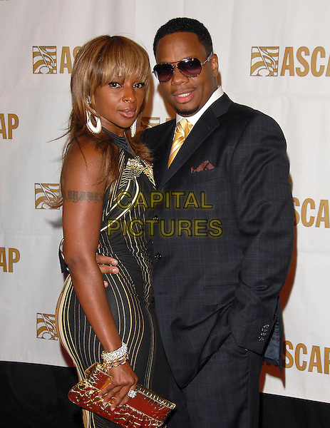 MARY J. BLIGE & KENDU ISAACS.attends The ASCAP Rhythm & Soul Awards 20th Anniversary held at The Millenium Biltmore Hotel in Los Angeles, California, USA, June 25 2007.                                     half length earrings black and gold dress married husband wife tattoo on arm.CAP/DVS.©Debbie VanStory/Capital Pictures