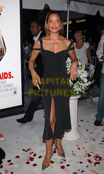 "MICHAEL MICHELLE.The premiere of the new film, ""The Wedding Crashers"", at the Ziegfeld Theater in Manhattan, New York, New York..July 13th, 2005.Photo Credit: Patti Ouderkirk/AdMedia.full length black dress off the shoulder slit split.www.capitalpictures.com.sales@capitalpictures.com.© Capital Pictures."