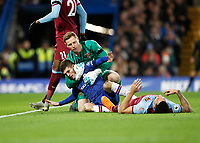 30th November 2019; Stamford Bridge, London, England; English Premier League Football, Chelsea versus West Ham United; Goalkeeper David Martin of West Ham United crashes into Christian Pulisic of Chelsea while attempting to catch the ball  - Strictly Editorial Use Only. No use with unauthorized audio, video, data, fixture lists, club/league logos or 'live' services. Online in-match use limited to 120 images, no video emulation. No use in betting, games or single club/league/player publications