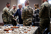 United States President Donald J. Trump, center left, and First Lady Melania Trump, second right, greet Marines while visiting Marine Barracks in Washington, D.C., U.S, on Thursday, Nov. 15, 2018. President Trump and the First Lady are meeting with Marines who responded to a building fire at the Arthur Capper Public Housing complex on September 9, 2018. <br /> Credit: Andrew Harrer / Pool via CNP