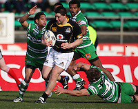Manawatu's Aaron Smith (left) and Mike Fitzgerald try to tackle Dane Coles during the Air NZ Cup preseason match between Manawatu Turbos and Wellington Lions at FMG Stadium, Palmerston North, New Zealand on Friday, 17 July 2009. Photo: Dave Lintott / lintottphoto.co.nz