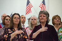 NWA Democrat-Gazette/CHARLIE KAIJO Congregants honor the National Anthem on Sunday, November 12, 2017 at Monte Ne Baptist Church in Rogers. The church held a special Veterans Day color guard ceremony with special guests from the American Legion Post 100