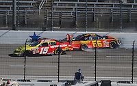 Nov. 7, 2009; Fort Worth, TX, USA; NASCAR Nationwide Series driver Steve Wallace (66) and Michael Annett (15) crash during the O'Reilly Challenge at the Texas Motor Speedway. Mandatory Credit: Mark J. Rebilas-