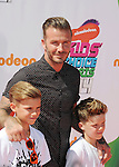 LOS ANGELES, CA- JULY 17: Former soccer player David Beckham, sons Romeo James Beckham (L) and Cruz David Beckham attend Nickelodeon Kids' Choice Sports Awards 2014 at Pauley Pavilion on July 17, 2014 in Los Angeles, California.