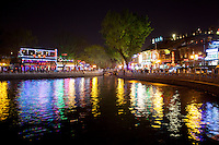Colorful lights at night reflecting off the water in the Houhai District of Beijing