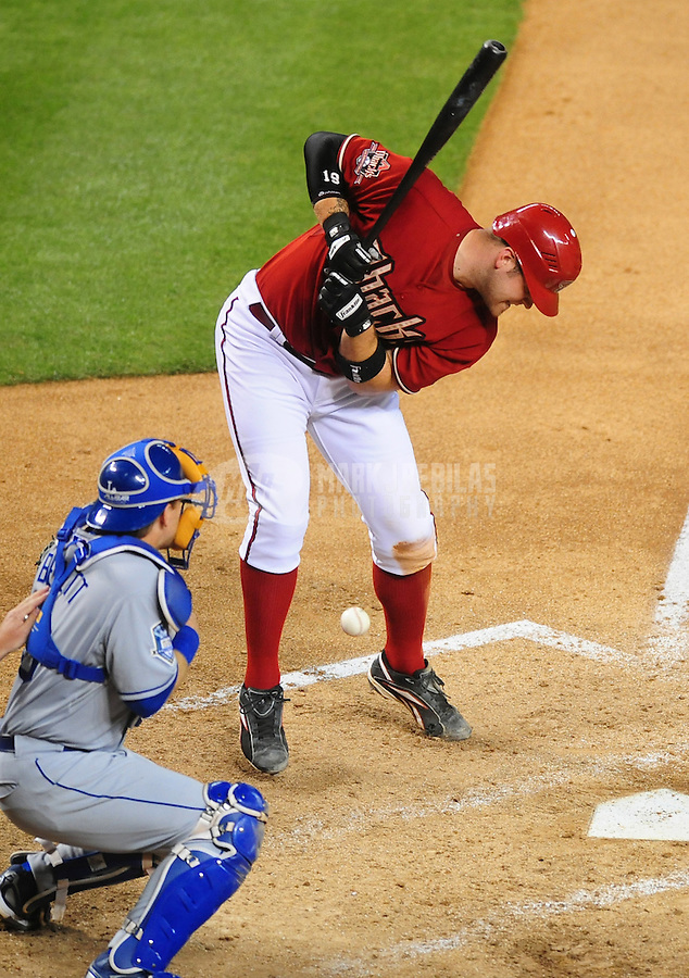 Apr. 8, 2008; Phoenix, AZ, USA; Arizona Diamondbacks catcher Chris Snyder is hit by a pitch in the third inning against the Los Angeles Dodgers at Chase Field. Mandatory Credit: Mark J. Rebilas-