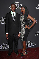 "20 September 2016 - Hollywood, California - Robert Katende and Phiona Mutesi. ""Queen Of Katwe"" Los Angeles Premiere held at the El Capitan Theater in Hollywood. Photo Credit: AdMedia"