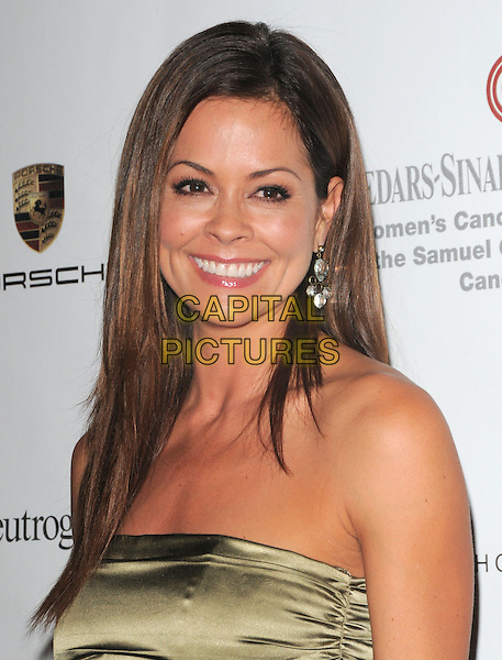 BROOKE BURKE .at 6th Annual Pink Party held at Drai's at The W Hotel in Hollywood, California, USA, September 25th 2010..portrait headshot smiling strapless green gold  khaki silk satin                                                                              .CAP/RKE/DVS.©DVS/RockinExposures/Capital Pictures.